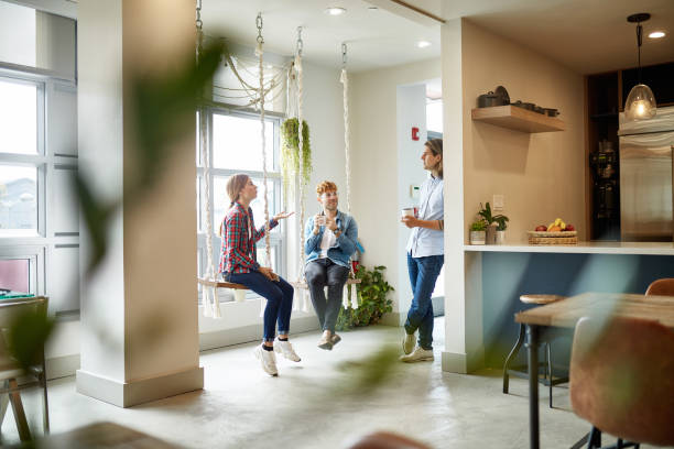 Casual Businesspeople Talking on Break in Coworking Office stock photo