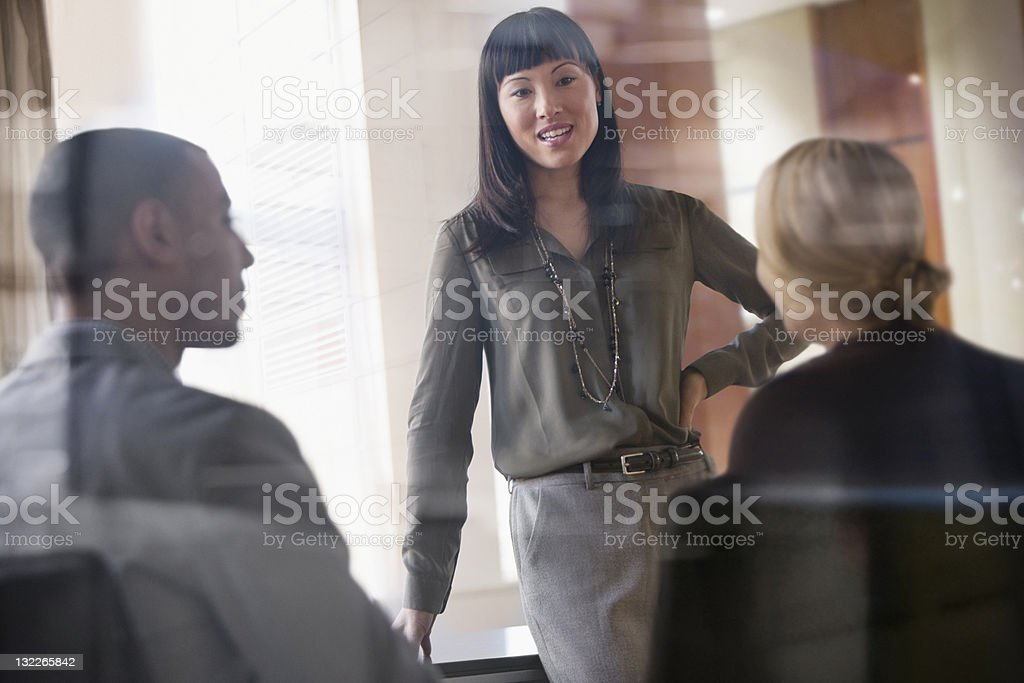 Casual businesswoman leading a meeting stock photo