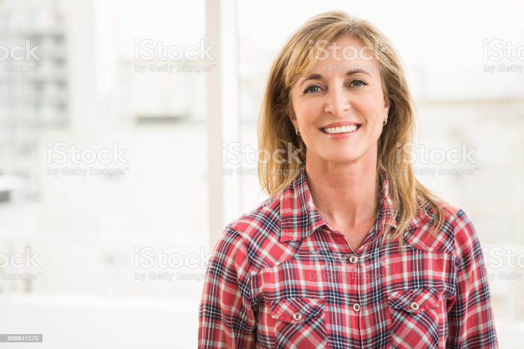 Casual businesswoman smiling to camera stock photo