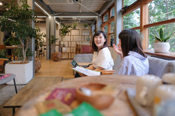 Casual businesswomen having business talk at cafe stock photo