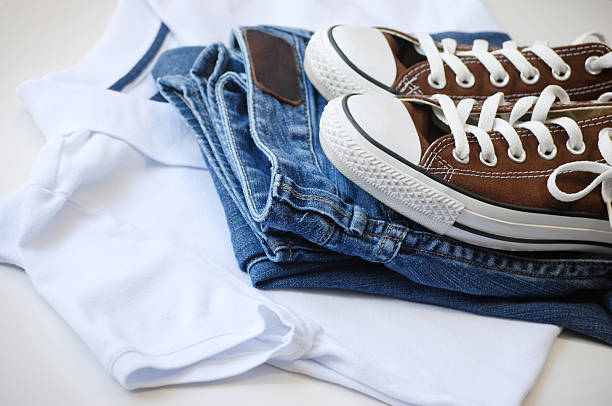 Casual clothes and shoes in a pile stock photo