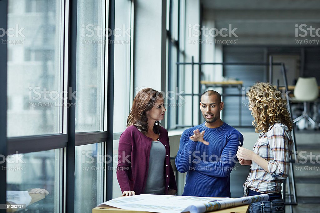Casual discussion between coworkers stock photo