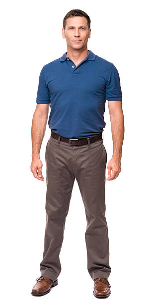 casual dressed man hands at sides isolated on white background - ayakta durmak stok fotoğraflar ve resimler