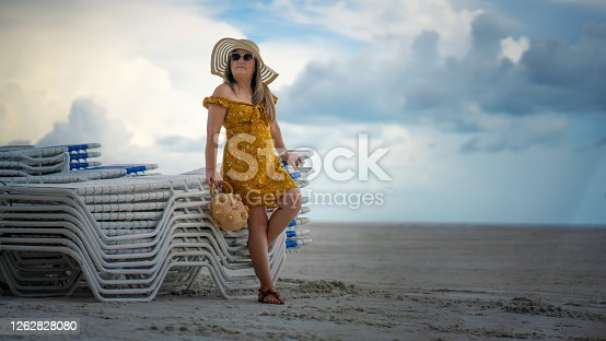 Casual elegant sixty year old latin woman on the beach