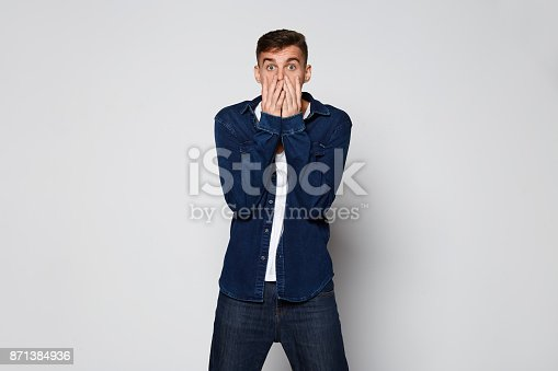 istock Casual emotional Man surpusing on white background 871384936