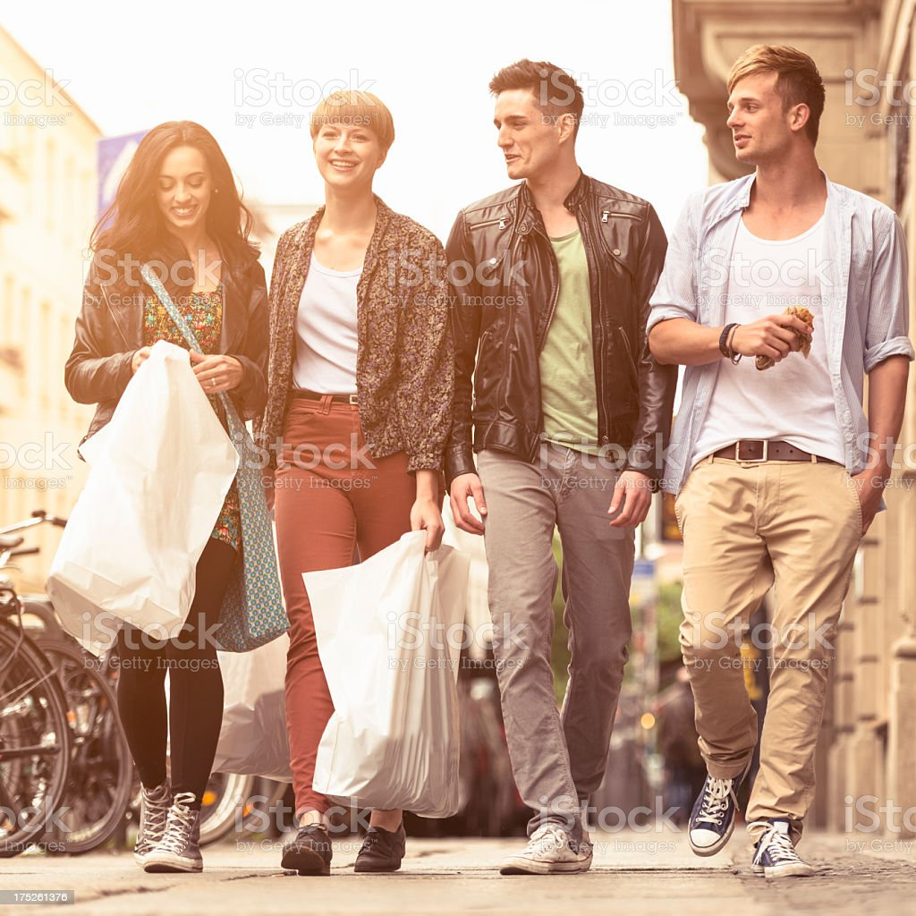 Casual friends walking after shopping in Berlin royalty-free stock photo