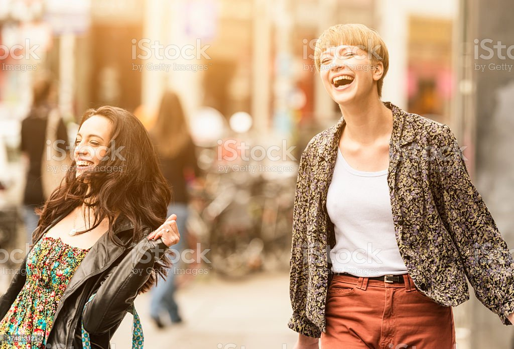 Casual friends walking after shopping royalty-free stock photo