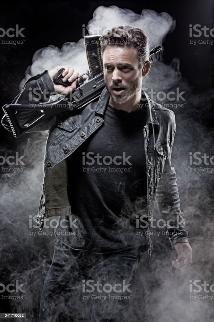 Casual gangster man in studio shot stock photo