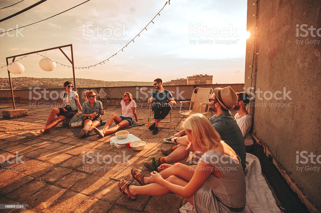 Casual gathering on the rooftop stock photo