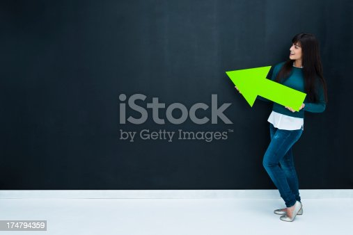 168589045istockphoto Casual girl pointing 174794359