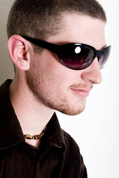 Casual guy in sunglasses stock photo