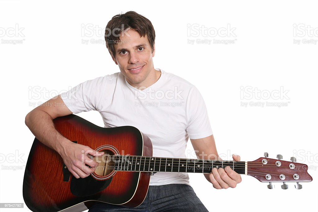 Casual guy playing guitar royalty-free stock photo