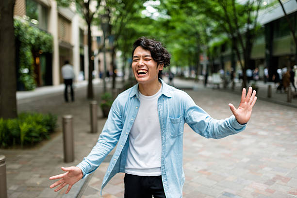 casual japanese man portrait on the street have fun ストックフォト