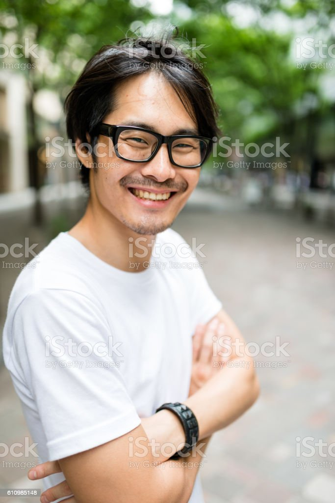 casual japanese man portrait on the street stock photo