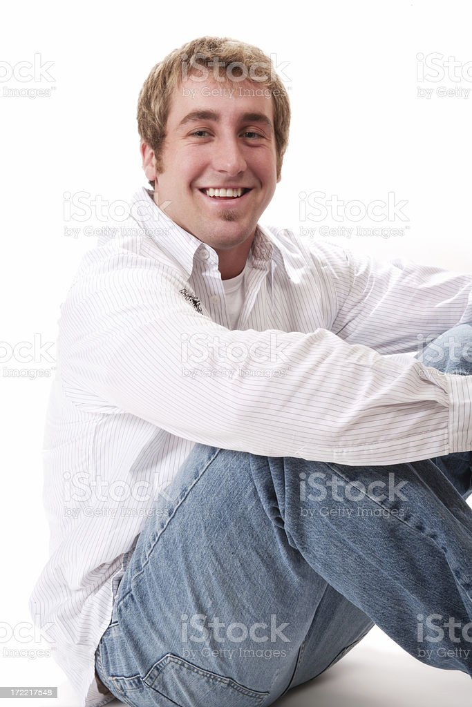 Casual Male Sitting on Floor royalty-free stock photo