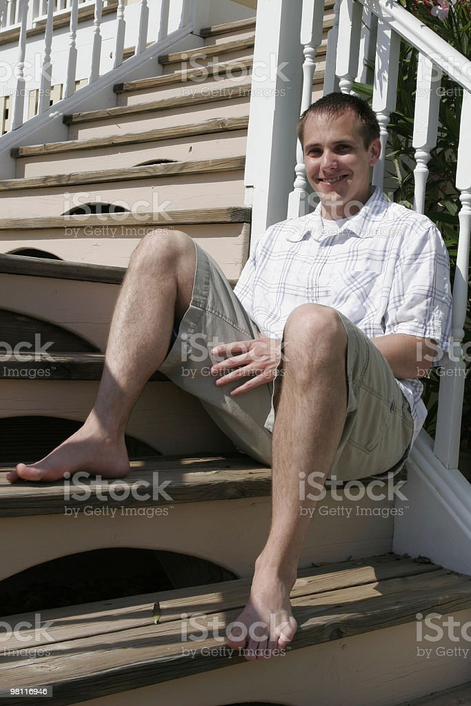Casual male sitting outside royalty-free stock photo