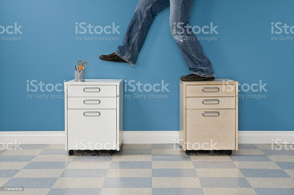 Casual Male Stepping Between File Cabinets royalty-free stock photo