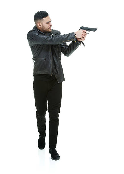 Casual man aiming with handgun stock photo
