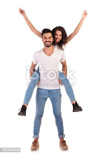 854381886 istock photo casual man and woman celebrate success together 922006438