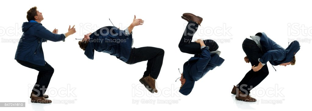 Casual man backflipping stock photo