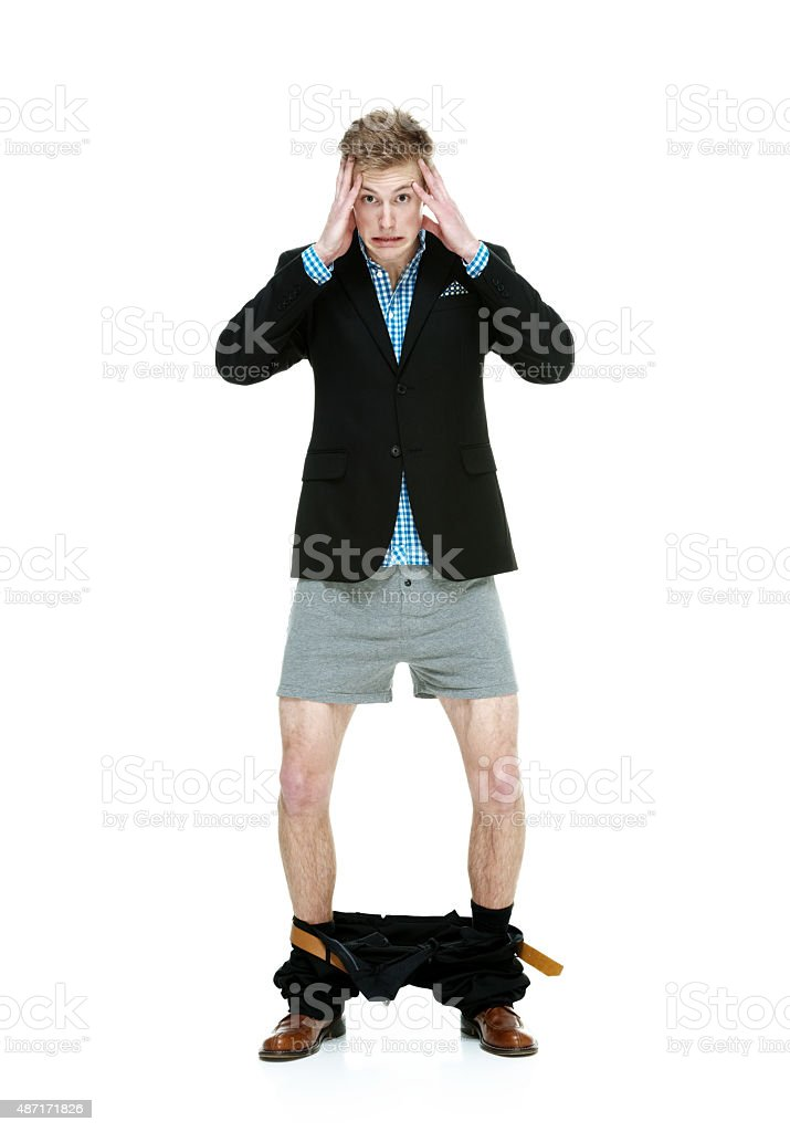 Casual man caught with his pants down stock photo