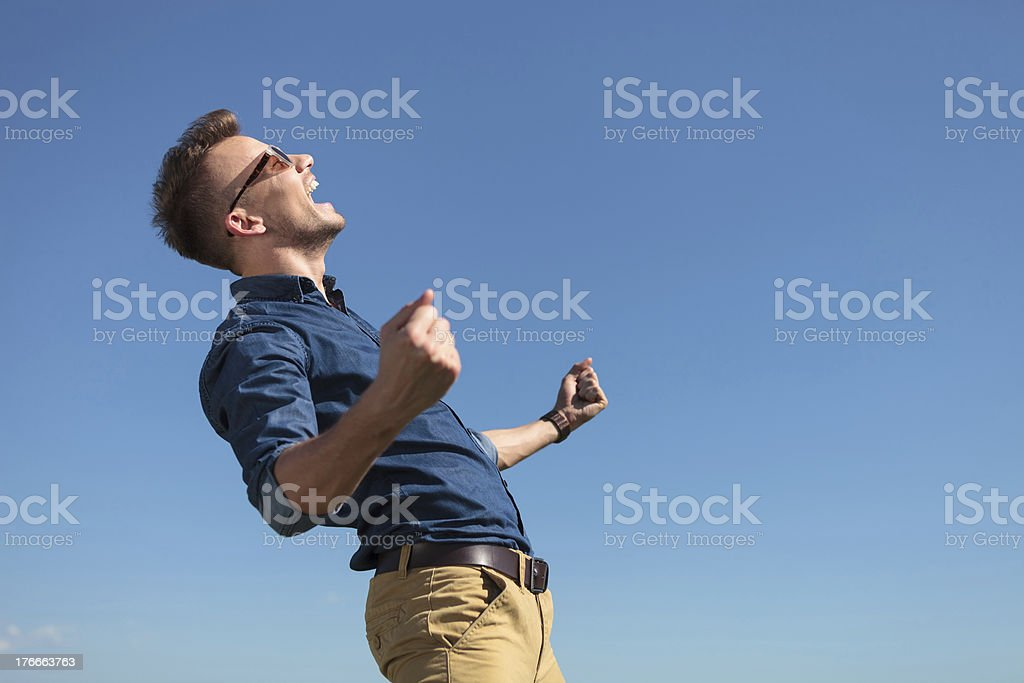 casual man cheering outdoors royalty-free stock photo