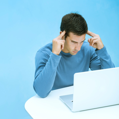 530281733 istock photo Casual man concentrated in laptop 174816903
