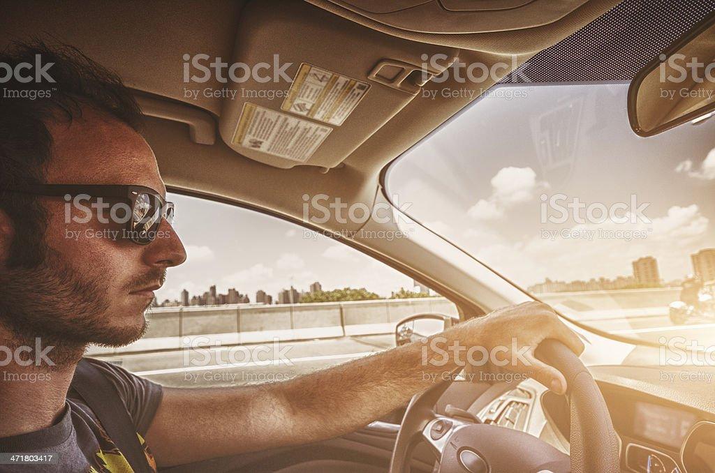 casual man driving his car royalty-free stock photo