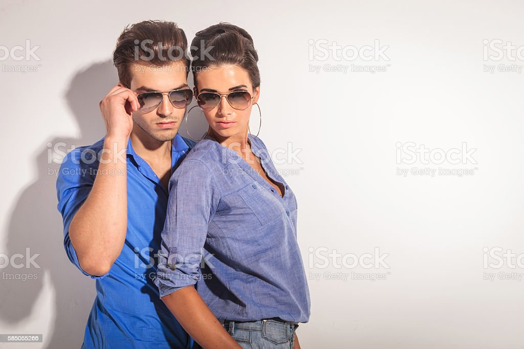 Casual man fixing his sunglasses stock photo
