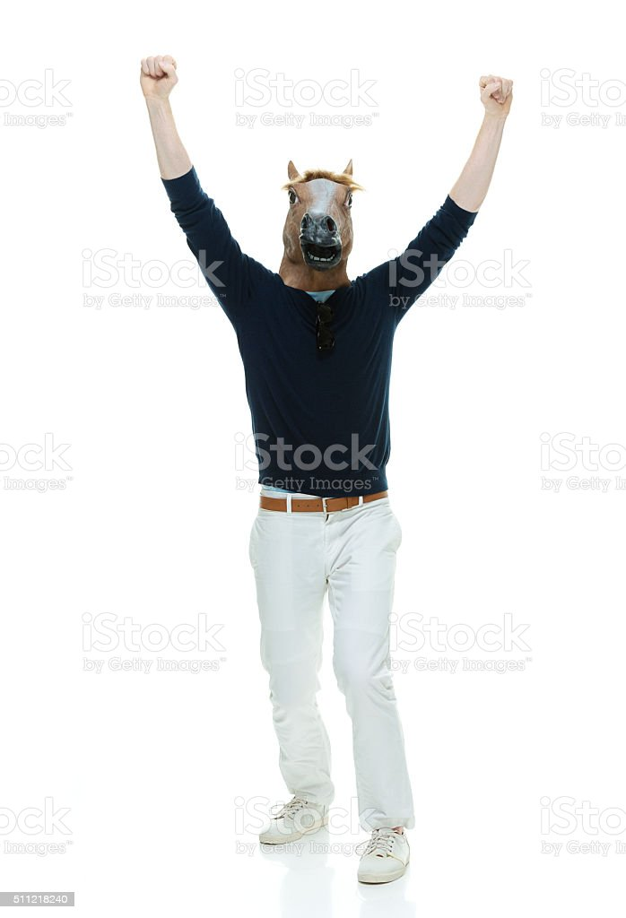 Casual man in horse costume and cheering stock photo