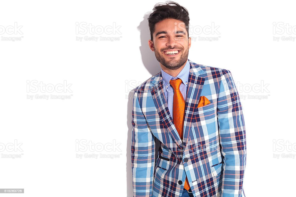 casual man in plaid jacket and orange tie stock photo