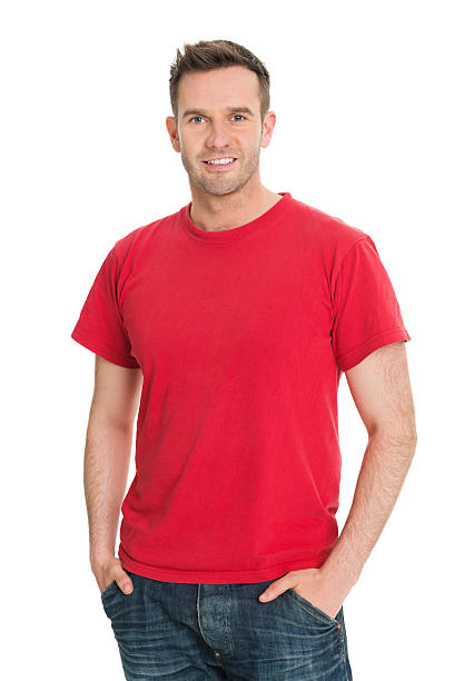 Casual Man in Red T Shirt Portrait of confident man standing with hands in pockets against white background red shirt stock pictures, royalty-free photos & images