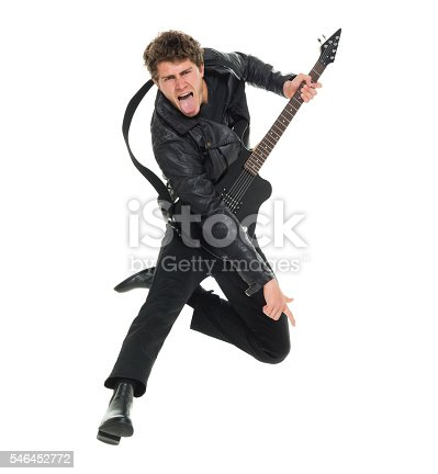 istock Casual man jumping and playing guitar 546452772