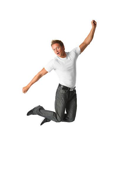 Casual homem pulando e posando ar - foto de acervo