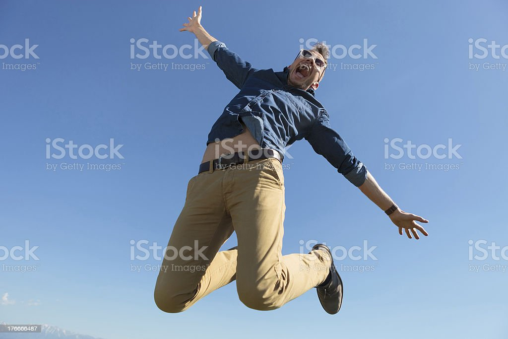 casual man jumps in mid-air royalty-free stock photo