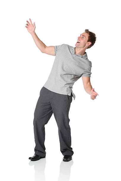 Casual man leaning backwards Casual man leaning backwardshttp://www.twodozendesign.info/i/1.png bending over backwards stock pictures, royalty-free photos & images