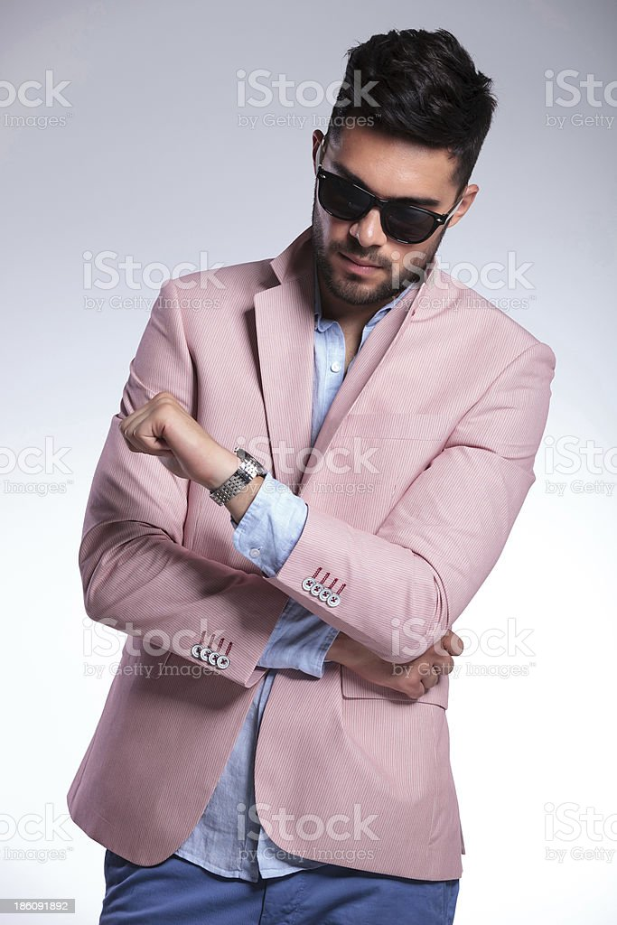 casual man looks at his watch royalty-free stock photo