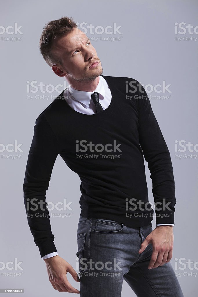 casual man looks up royalty-free stock photo
