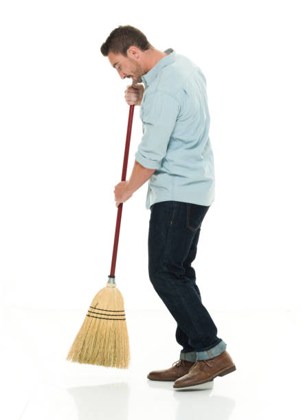casual man moping the ground - sweeping stock pictures, royalty-free photos & images