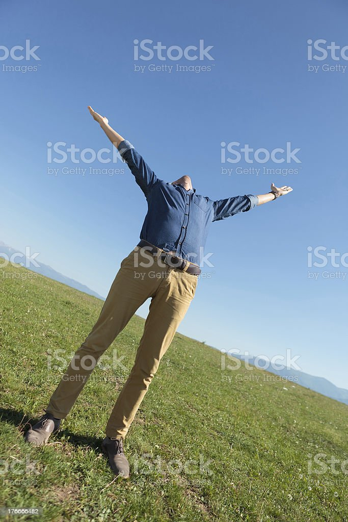casual man outdoors with arms opened royalty-free stock photo