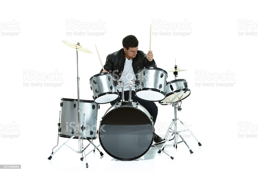 Casual man playing drums stock photo
