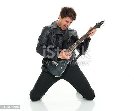 istock Casual man playing guitar 601020586