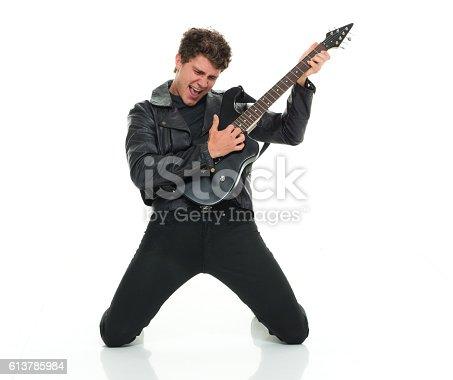 istock Casual man playing guitar 613785984