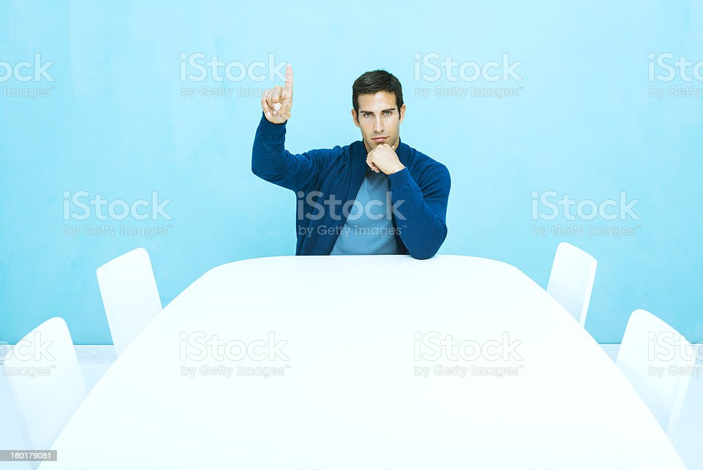Casual man pointing up stock photo