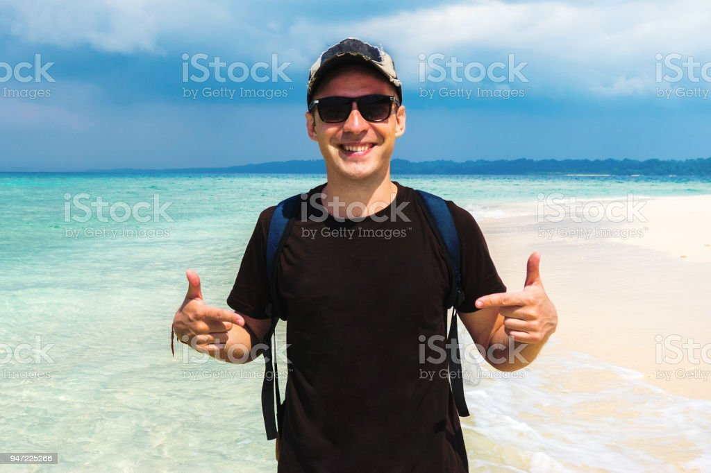 Casual man pointing with both hands to his blank stock photo