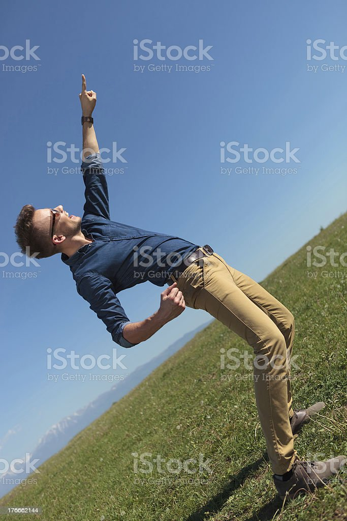 casual man points at the sky royalty-free stock photo