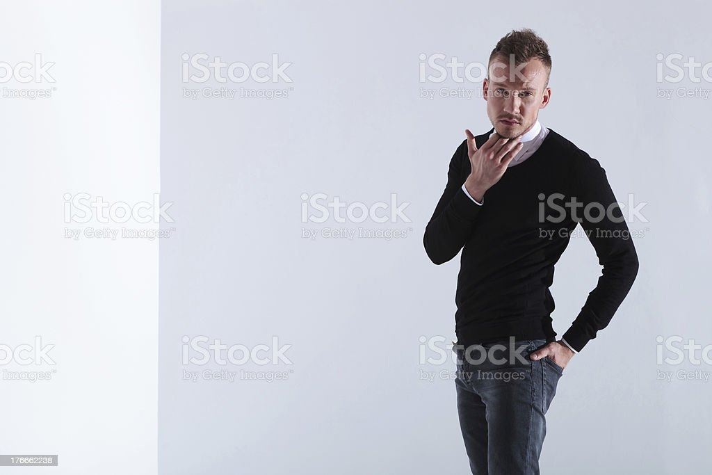 casual man scratches his beard royalty-free stock photo