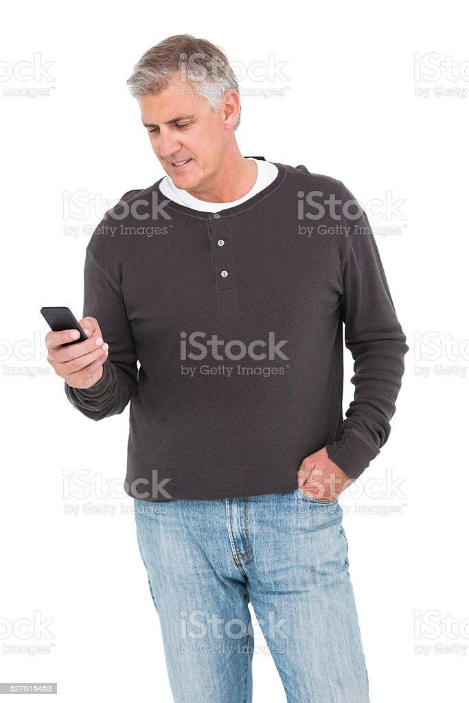 Casual man sending a text stock photo