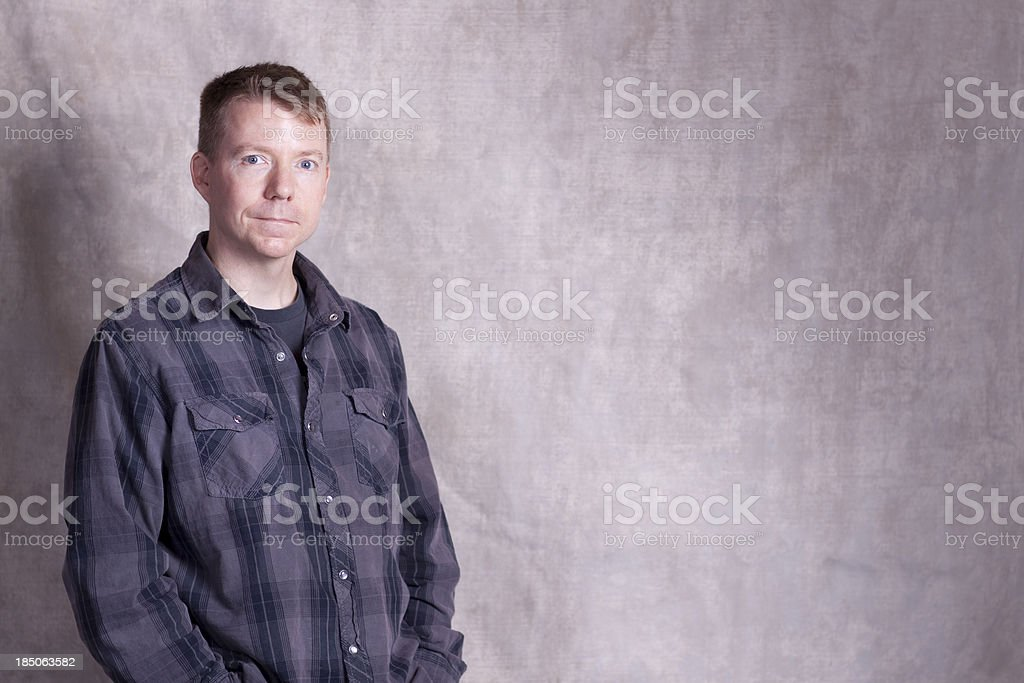 casual man standing with rugged background stock photo