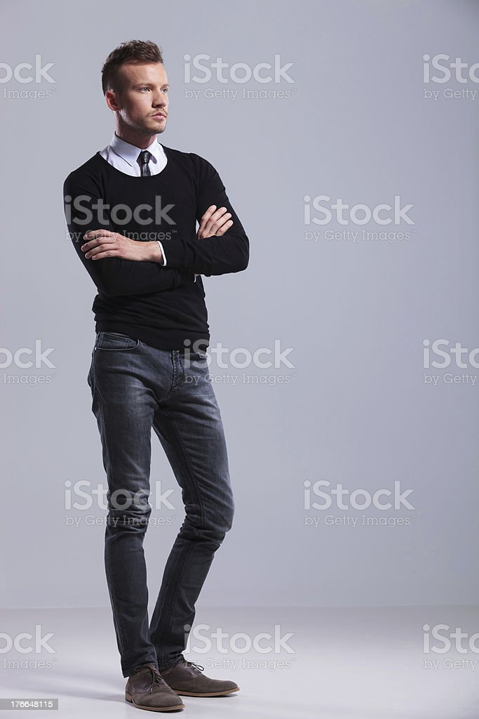 casual man stands with hands folded royalty-free stock photo